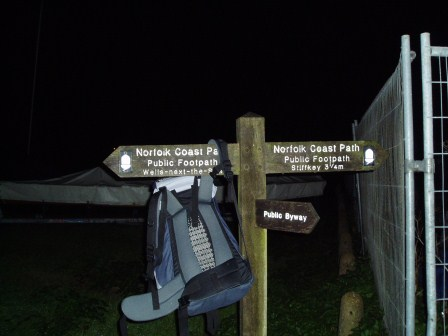 My Rucksack hanging on the Coastal Path Sign at Wells