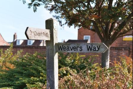 The Last sign of the Norfolk Coast Path and the First of the Weavers Way